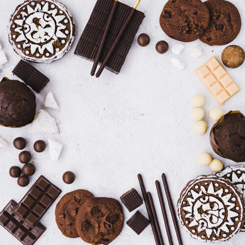 empty-frame-made-with-chocolates-products-white-background