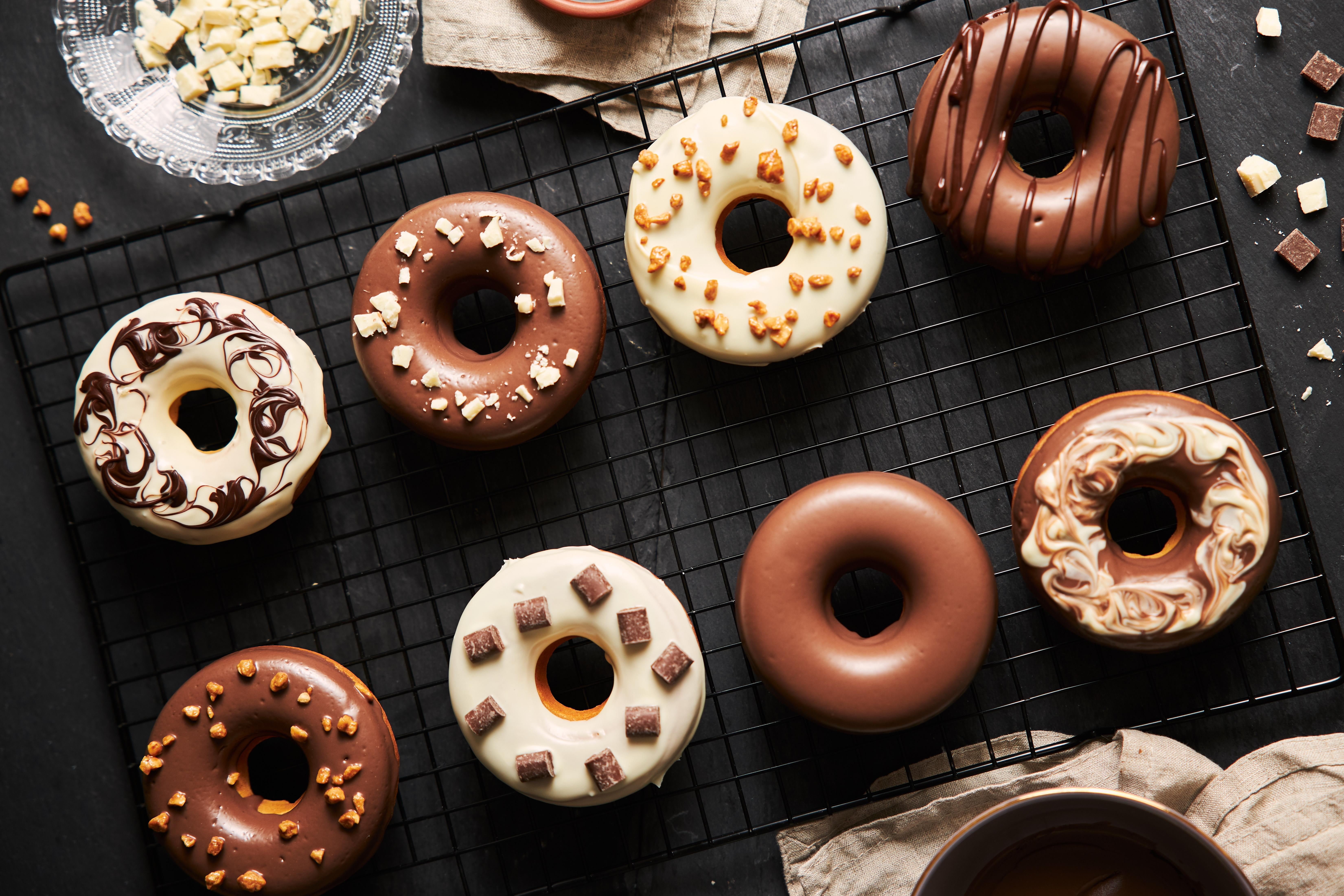 Various donuts glazed in white and milk chocolate